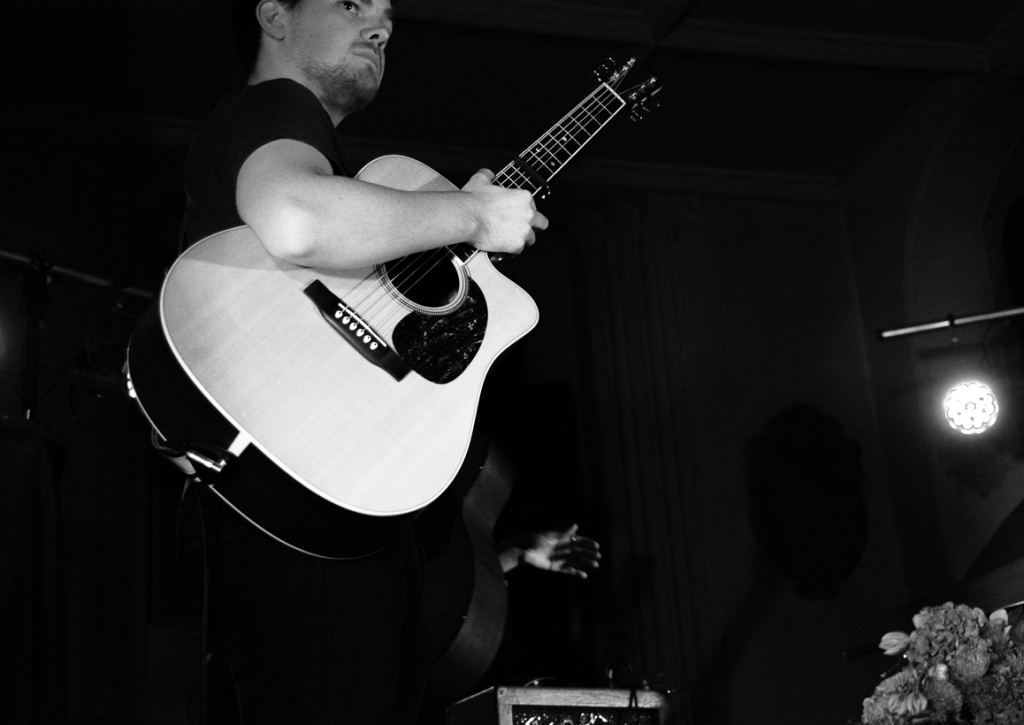 Guitarist plays with Sophie Delila at St Pancras Old Church, London